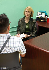 Melinda interviewing a client in a private office.