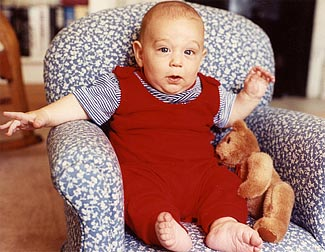 Renita's son Mikey in a little rocking chair