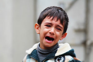 young boy crying