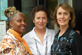 Wanda, Renita, and Melinda standing outside the MNRC